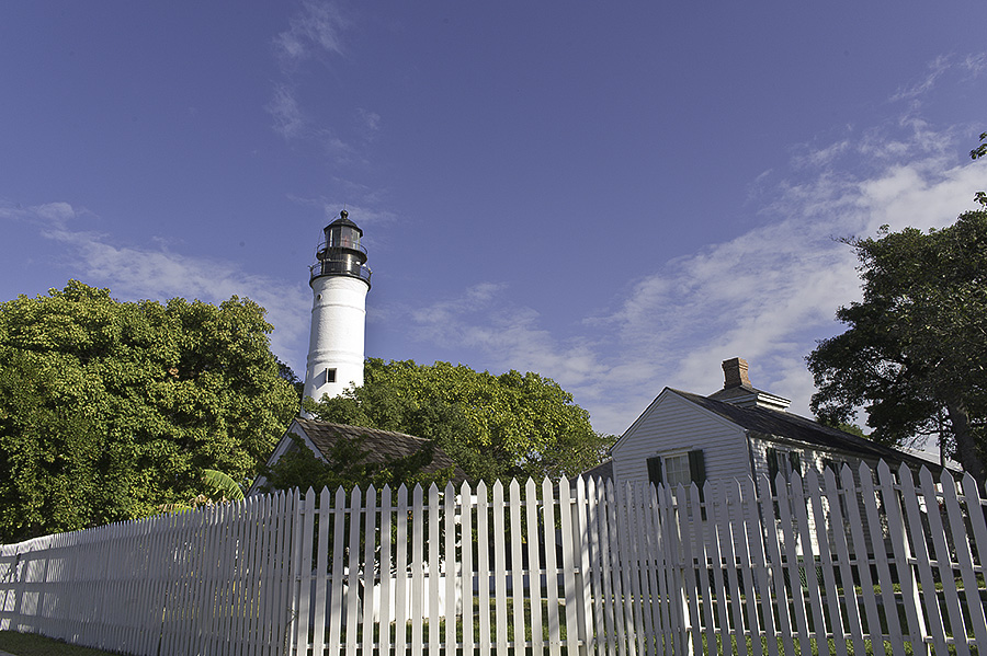 key west lighthouse surrounded by white picket fence